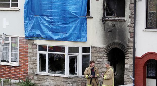 Firefighters at the scene of the house fire in Chatham, Kent, where a woman and an infant boy were killed
