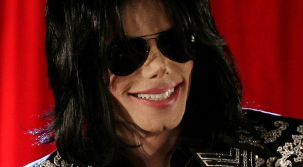 Michael Jackson's brother Jermaine has revealed a plan to secretly fly his sibling to Bahrain if he was found guilty of child abuse