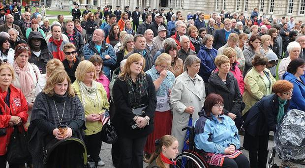 Crowds gather to pay their respects outside Belfast City Hall