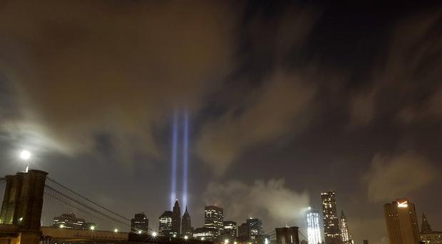 The Tribute in Light rising over the Brooklyn Bridge and lower Manhattan in remembrance of the 9/11 victims(AP)