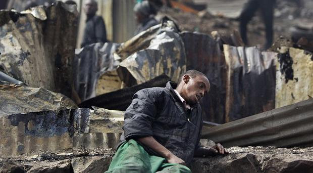 A man sits in a state of shock after the blast in Nairobi (AP)