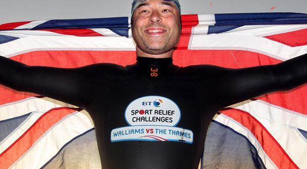 David Walliams celebrates as he completes his 140-mile charity swim along the River Thames