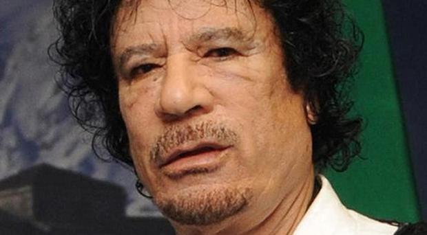 Fugitive leader Muammar Gaddafi accused rebels of handing Libya over to foreign influence and vowed to press ahead with his resistance