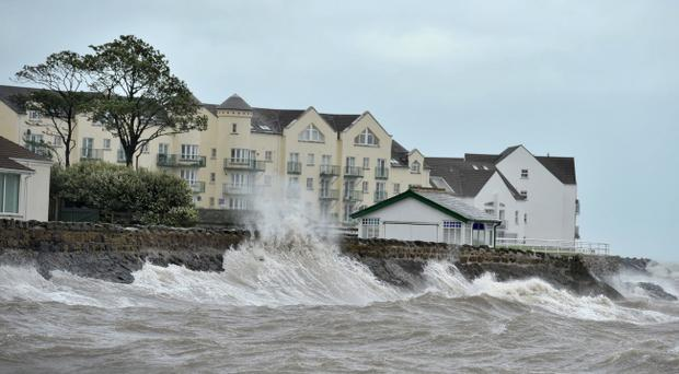 The Coast Road Carrickfergus, as the waves crashes over the walls.Northern Ireland is being battered with extreme weather conditions as the tail end of Hurricane Katia sweeps across the Atlantic.