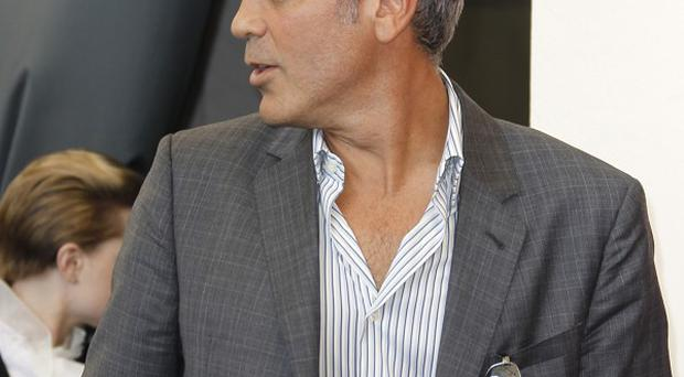 George Clooney says acting is still his main job