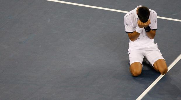 NEW YORK - SEPTEMBER 12: Novak Djokovic of Serbia reacts after he won match point against Rafael Nadal of Spain during the Men's Final on Day Fifteen of the 2011 US Open at the USTA Billie Jean King National Tennis Center on September 12, 2011 in the Flushing neighborhood of the Queens borough of New York City. (Photo by Jared Wickerham/Getty Images for USTA)