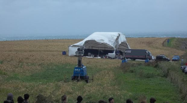 Actors and extras keep away from the destruction caused by the gale force winds that ripped a steel framed marquee right out of the ground, it was being used to hold the actors and extras and several were injured as a result on the Game of Thrones set in Co Antrim. Picture submitted by Ryan McAnearney