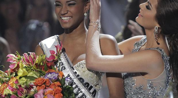 Miss Angola Leila Lopes is crowned Miss Universe 2011 by Miss Universe 2010 Ximena Navarrete, of Mexico (AP)