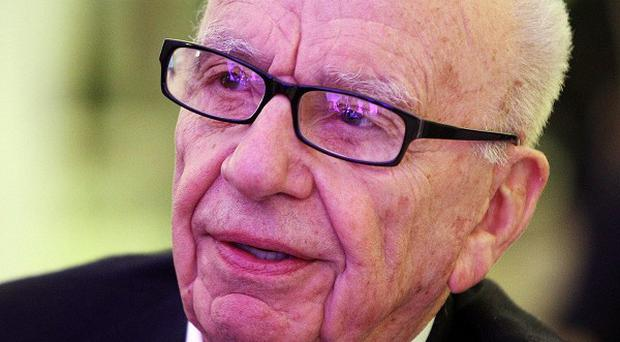 Australia's government has promised a media inquiry amid complaints Rupert Murdoch's News Corp owns too many newspapers