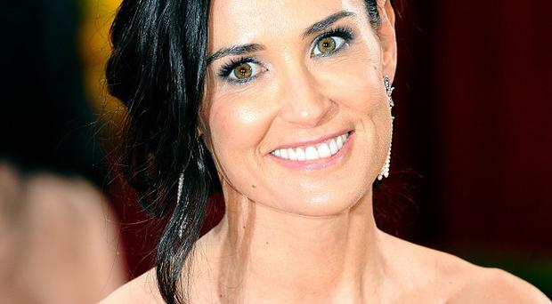 Demi Moore showed off her naked back on Twitter