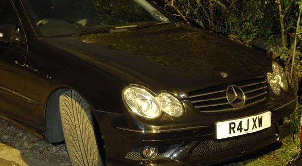 The black Mercedes CLK coupe owned by Harjinder Singh Bhurji, who was stabbed by a masked man who stole the vehicle