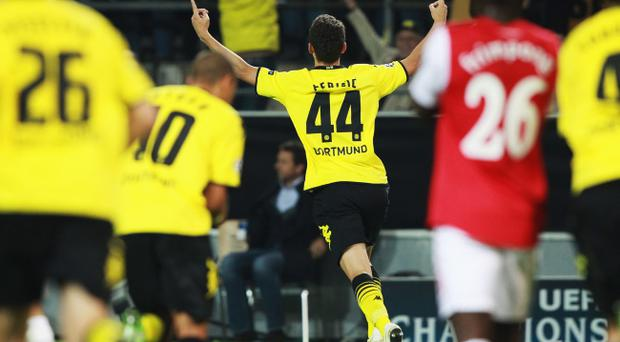 DORTMUND, GERMANY - SEPTEMBER 13: Ivan Perisic of Dortmund celebrates after scoring his team's first goal during the UEFA Champions League Group F match between Borussia Dortmund and Arsenal FC at Signal Iduna Park on September 13, 2011 in Dortmund, Germany. (Photo by Joern Pollex/Bongarts/Getty Images)