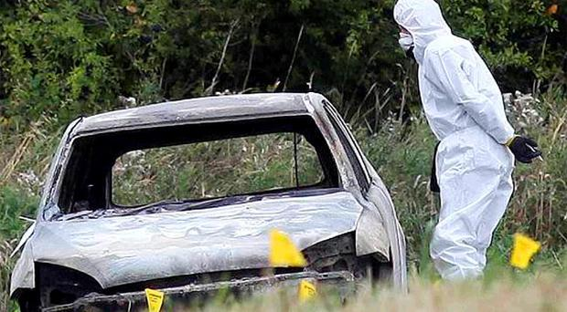 Forensic experts pictured at the scene where Cyril and Phyllis Gardners' car was found
