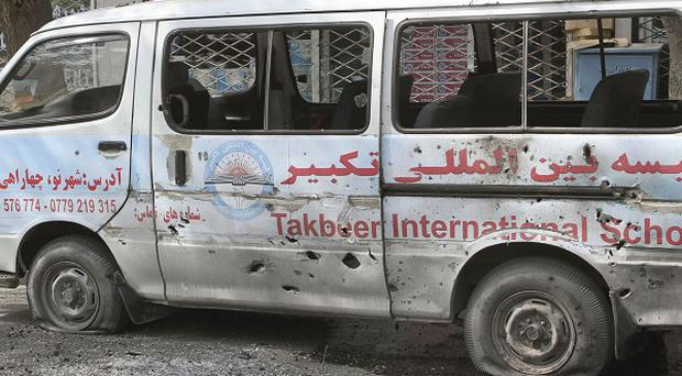 A damaged minibus abandoned after it was hit byTaliban gunmen in Kabul during attacks on the US Embassy, Nato headquarters and other buildings(AP)