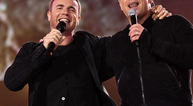 Robbie Williams (right) was helping Gary Barlow pick contestants