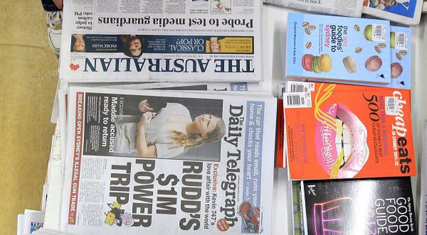 An official inquiry will examine increasing regulation in Australian print media, a government official said
