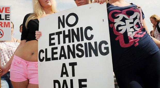 Travellers take part in a march and demonstration against their forced eviction from the Dale Farm site in Essex