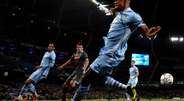 MANCHESTER, ENGLAND - SEPTEMBER 14: Vincent Kompany of Manchester City blocks the attempt on goal of Christian Maggio of Napoli during the UEFA Champions League Group A match between Manchester City and SSC Napoli at the Etihad Stadium on September 14, 2011 in Manchester, England. (Photo by Laurence Griffiths/Getty Images)
