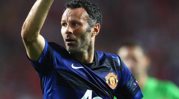 LISBON, PORTUGAL - SEPTEMBER 14: Ryan Giggs of Manchester United celebrates his goal during the UEFA Champions League Group C match between SL Benfica and Manchester United at the Estadio da Luz on September 14, 2011 in Lisbon, Portugal. (Photo by Clive Mason/Getty Images)