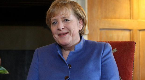 Angela Merkel sought to calm market fears that Greece was heading for a chaotic default