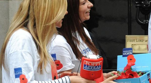 A council has reversed its decision to ban poppy appeal collectors from some parts of a city centre