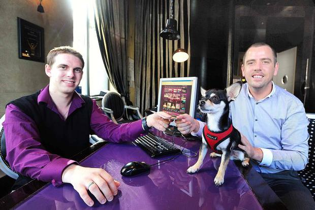Peter Harper checks Gary Quate from NITB and his dog Jackson into the Malmaison which is one of Northern Ireland's pet friendly hotels