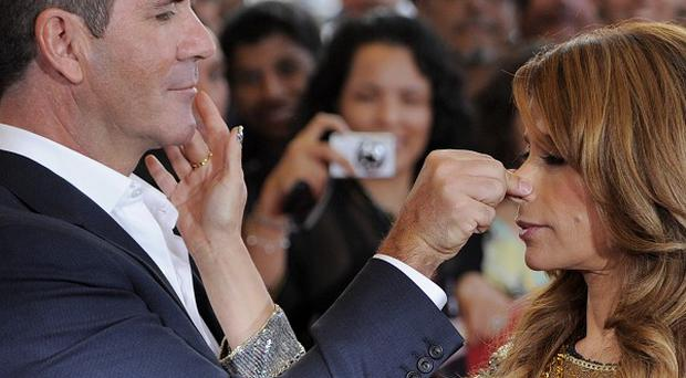Simon Cowell is glad to be back working with Paula Abdul again