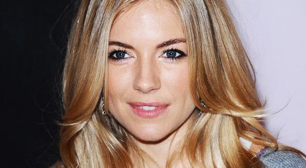 Actress Sienna Miller said she became paranoid when details of her life appeared in tabloids
