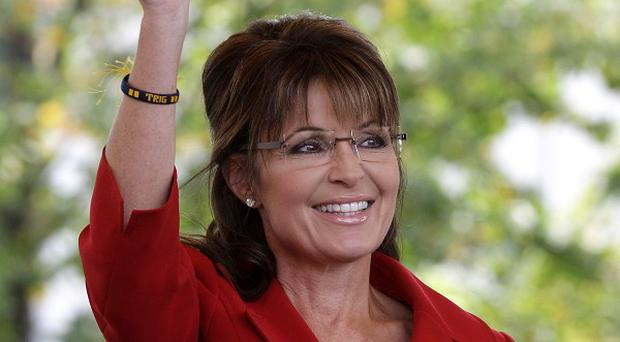 Sarah Palin's allies are seeking to discredit a racy new biography of the former Alaska governor (AP)