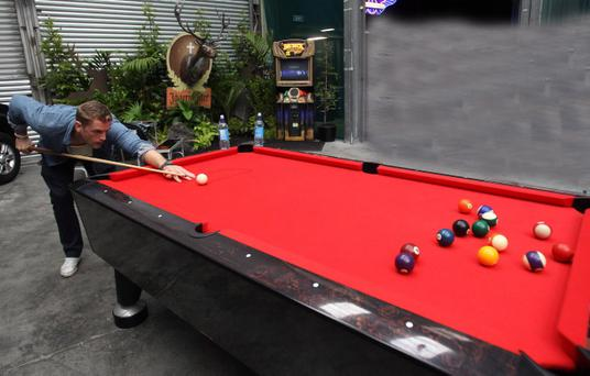 Ireland number eight Jamie Heaslip relaxes yesterday with a game of pool at the Puma Village in Auckland