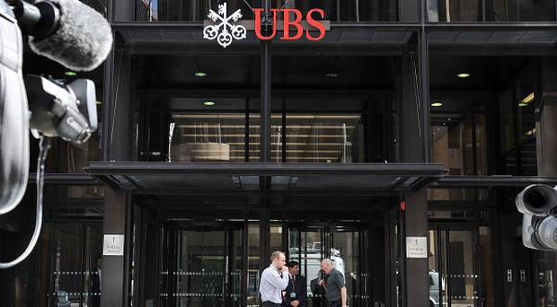 Swiss bank UBS said a rogue trader had cost it an estimated 1.3 billion pounds