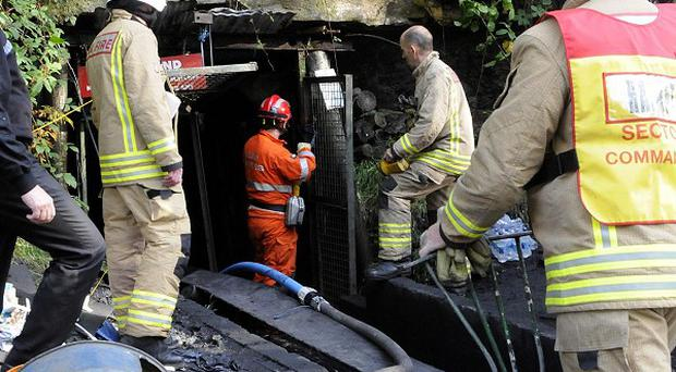 Emergency workers at the scene in Gleision Colliery near Swansea, South Wales, where four men are trapped