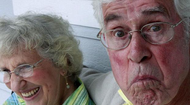 Bruce Huffman makes a monkey face as his wife Esther laughs (AP)