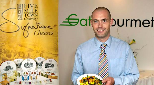 Owen Jones of Fivemiletown Creamery samples some of the speciality cheese