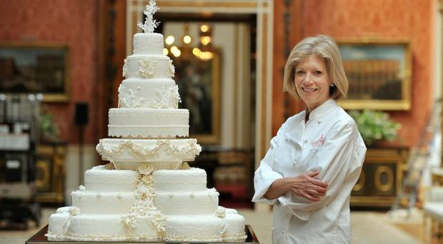 Fiona Cairns stands next to the Royal Wedding cake that she and her team at Fiona Cairns Ltd of Leicestershire made for Prince William and Catherine Middleton