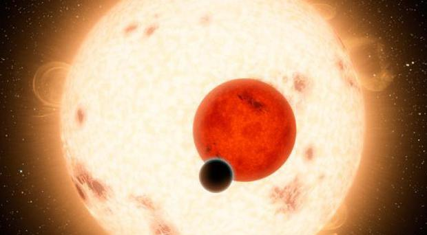 An artist's depiction showing a discovery by Nasa's Kepler mission of a world where two suns set over the horizon (AP/Nasa)