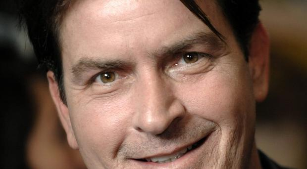Charlie Sheen seemed in a forgiving mood towards his old workplace when he appeared on the Tonight Show (AP)