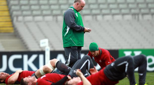 Ireland Coach Declan Kidney looks at his notes during training earlier today at Eden Park, Auckland