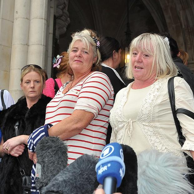 Dale Farm residents outside court after lawyers failed in a last-ditch attempt to prevent the eviction of families from an Essex site