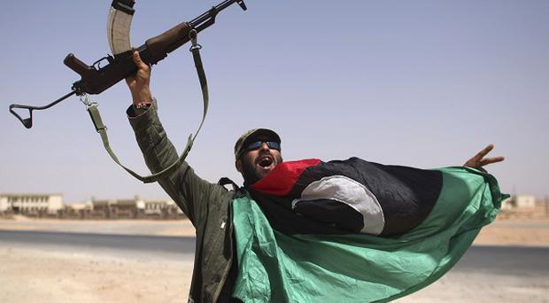Libyan fighters had to pull back from Bani Walid, one of the remaining bastions of Gaddafi, as they faced fierce attacks (AP)