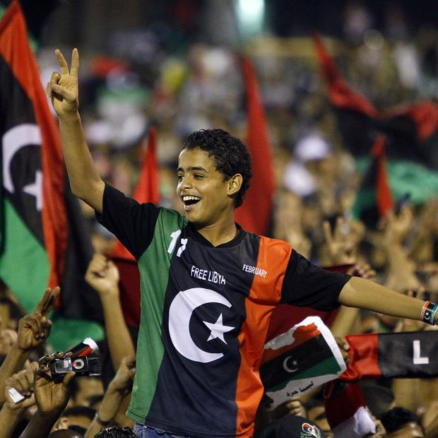 Libyan revolutionary supporters react as Libyan Transitional National Council chairman Mustafa Abdel Jalil delivers his speech inTripoli (AP)