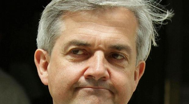 Chris Huhne said families 'do not bother' to hunt for bargains on gas and electricity