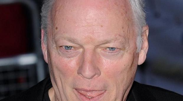 David Gilmour must pull down a beach hut at his seafront mansion in Hove or face prosecution