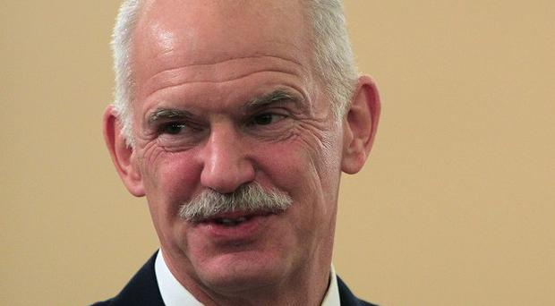Greek PM George Papandreou has reportedly cancelled his trip to the US (AP)