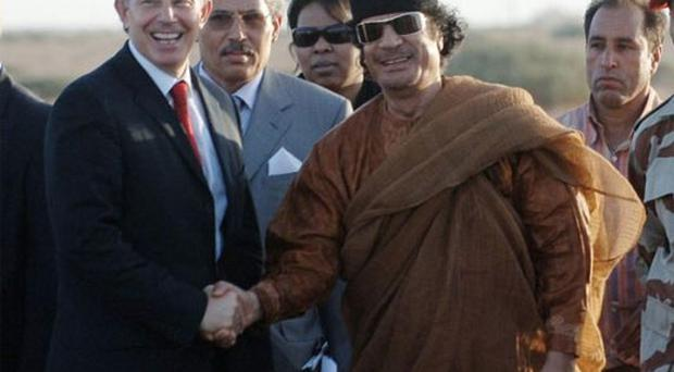The former PM Tony Blair and Colonel Gaddafi shake hands on 29 May 2007 after an hour long meeting The former PM Tony Blair and Colonel Gaddafi shake hands on 29 May 2007 after an hour long meeting