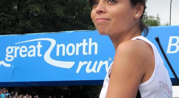 Dr Emma Egging watches as the Red Arrows fly over the start line of the Great North Run in honour of her late husband