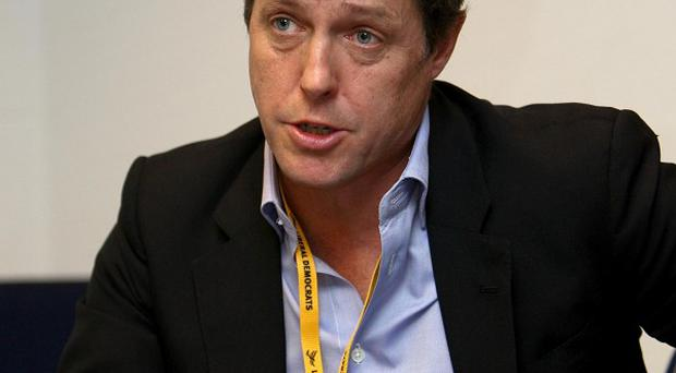Actor Hugh Grant at a fringe meeting arranged by 'Hacked Off' during a session of the Liberal Democrat annual conference