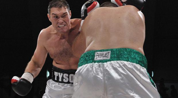 Tyson Fury lands a punch on Nicolai Firtha on his way to a fifth round victory in their heavyweight contest at the King's Hall