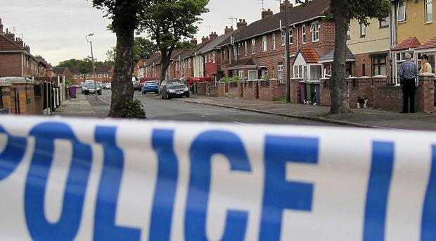 A murder probe has been launched after a woman was found shot dead in Devon