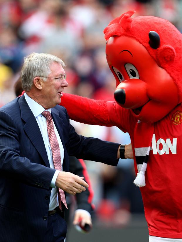 MANCHESTER, ENGLAND - SEPTEMBER 18: Manchester United Manager Sir Alex Ferguson is greeted by mascot Fred the Red prior to the Barclays Premier League match between Manchester United and Chelsea at Old Trafford on September 18, 2011 in Manchester, England. (Photo by Clive Brunskill/Getty Images)